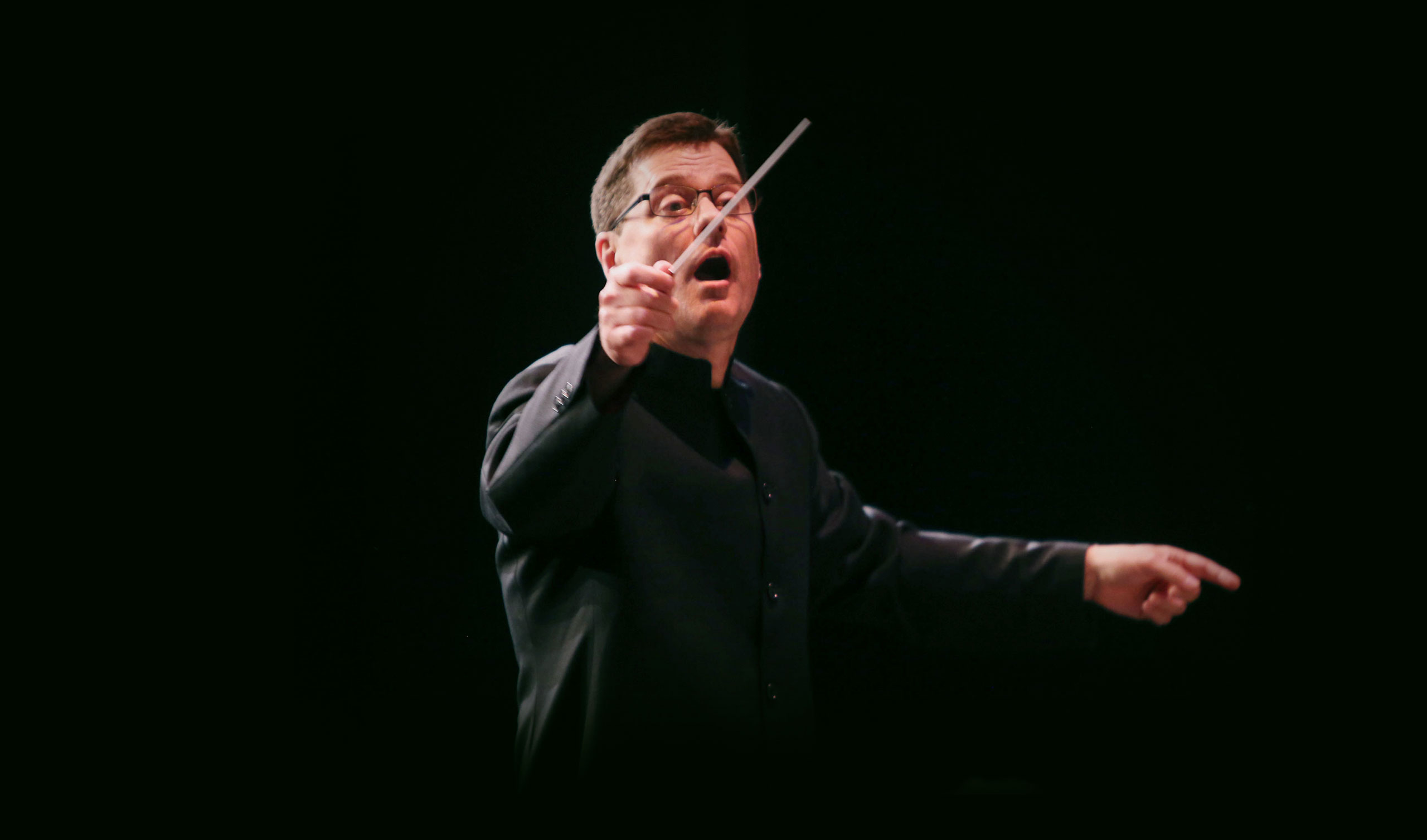 Cal State LA Conductor leading student orchestra in the State Playhouse